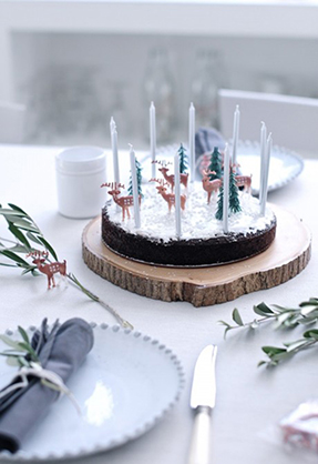 christmas cake with candles and reindeer christmas spirit_feat