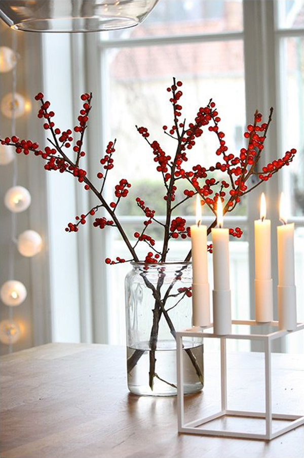 red chrsitmas berries and candles decor