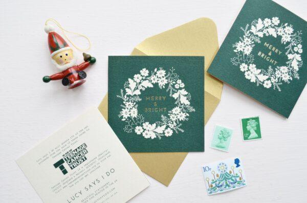 lsid charity christmas card soft pink dark green gold foil wreath